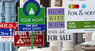 Homes for sale signs