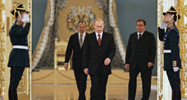 Russian President Vladimir Putin, center, followed by Foreign Minister Sergey Lavrov, left, and Putin foreign policy aide Sergei Prikhodko