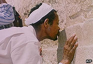Ethiopian Jew kissing wall in Israel
