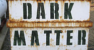 A rusty container, marked 'dark matter'