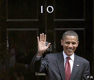 Barack Obama standing in front of the door to 10 Downing Street