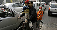 Family on a bicycle (AP Photo/Manish Swarup)
