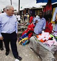 International Monetary Fund (IMF) Managing-Director Dominique Strauss-Kahn touring a local neighborhood market in Dar es Salaam, Tanzania on March 9, 2009.