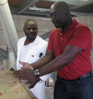Komla is shown how wheat is processed at Zambeef