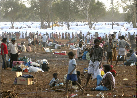 Displaced Sri Lankan ethnic Tamils are seen near their tents at a transit camp in Vavuniya