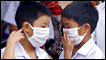Thai students wear face masks at a school in Bangkok on June 11, 2009