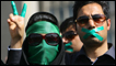 Supporters of opposition leader Mir Hossein Mousavi listen to his speech at a demonstration in Tehran
