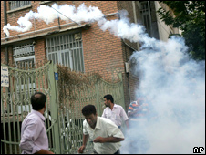 Supporters of opposition leader Mir Hossien Mousavi run from tear gas fired by riot police during a protest in Tehran on Saturday June, 20, 2009