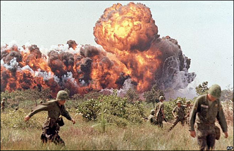 Soldiers run from napalm attack in the USA Vietnam war