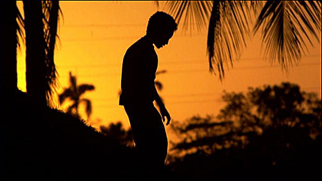 The sillouette of a boy against a sunset, Nicaragua