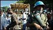 United Nations soldiers secure the scene in Haiti as food is distributed