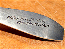 A close up of the engraving on one of Hitler's fish knives