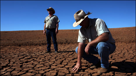 Farmers Spike and Tim Orr stand in a dry dam on their 10,000 acre property on January 26, 2010 in Parkes, Australia