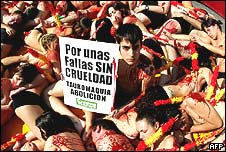 Anti-bullfighting demonstrators with banner and fake blood