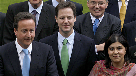 Baroness Warsi (right) with Prime Minister David Cameron (left) and Deputy Prime Minister Nick Clegg (centre)