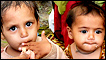 Young flood survivors eat food at a makeshift camp in Nowshera, 8 August 2010