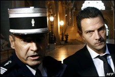 Jerome Kerviel accompanied by a French police officer