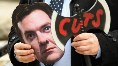 A man holding a mask depicting the face of George Osborne and an axe