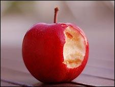 Una manzana roja mordida