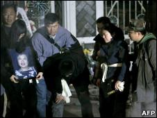 上海大火死難者親屬痛悼