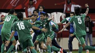 لاعبو المنتخب العراقي يحتفلون بالفوز
