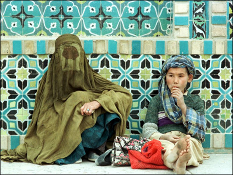 An Afghan woman and boy. Getty