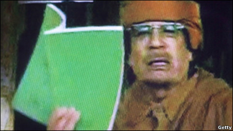Colonel Gaddafi brandishes a green book