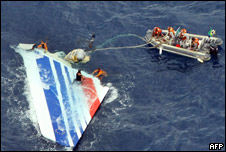 Brazilian Navy divers recovering part of the tail section from the Air France aircraft that crashed over the Atlantic ocean in 2009