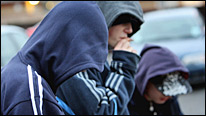 Young men in hooded tops