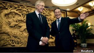 美国参议院多数党领袖里德和中国副总理王岐山