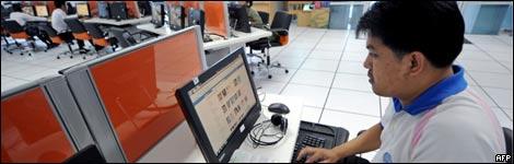 Man using a computer at Rajabhat University in Bangkok, Thailand