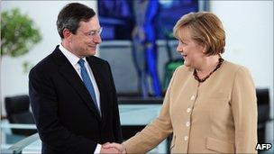 Mario Draghi y Angela Merkel