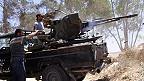 Rebeldes libios y arma