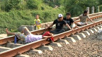People on train tracks in Indonesia