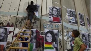 Fotos de crianças palestinas com bandeiras de países que devem aprovar a criação de um Estado Palestino
