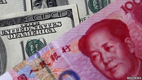 美元与人民币(资料照片)