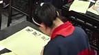 Clase de caligrafia en escuela china