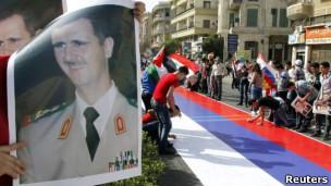 تظاهرات طرفداران اسد و پرچم روسیه