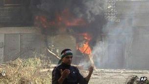 Ativista sírio em Homs. AP
