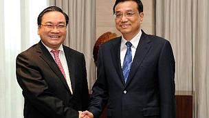 Phó Thủ tướng Hoàng Trung Hải (trái)