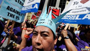 Activistas contra los impuestos de las grande corporaciones