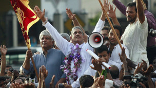 Former General Sarath Fonseka saluting his supoorters (file photo)