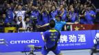 Pemain ganda putra Cina, Cai Yun, merayakan kemenangan di Wuhan, 27 Mei 2012.