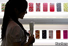 A young woman looking at mobile phones