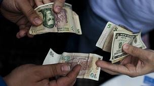 Cambio de pesos a dólares