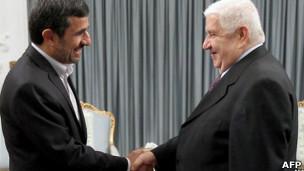 El presidente de Irán y el canciller de Siria en un encuentro reciente