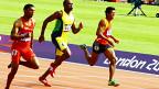 नेपाली धावक तिलकराम थारू (दायाँ पट्टी रातो टिशर्टमा) लण्डन ओलिम्पिक्सको १०० मिटर दौडमा