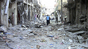 Imagem tirada de um vídeo amador mostra o que seria a destruição de bairro em Damasco, Síria (AP)