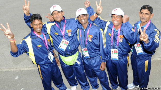 Lal Pushpakumara and lesly Kumara together with their coaches