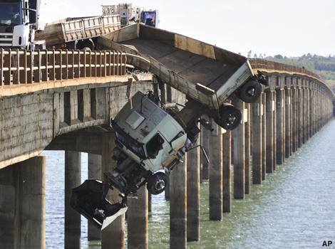 A truck hangs from the Chavantes bridge near Fartuna, Brazil.